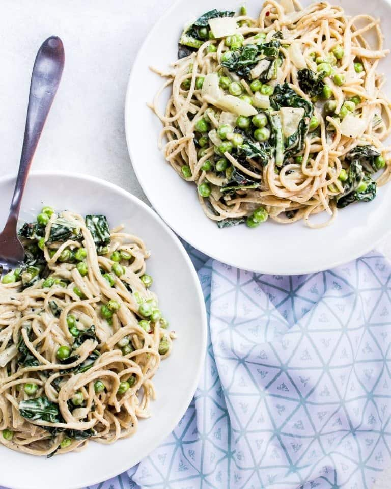spicy tahini pasta with sauteed kale + peas + onion