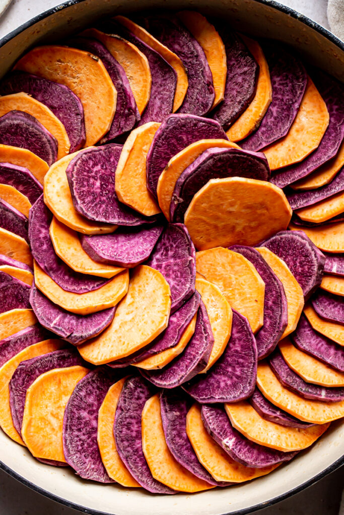 a close up of the unfrosted sweet potatoes in a swilrl pattern with alternating purple and orange sweet potatoes