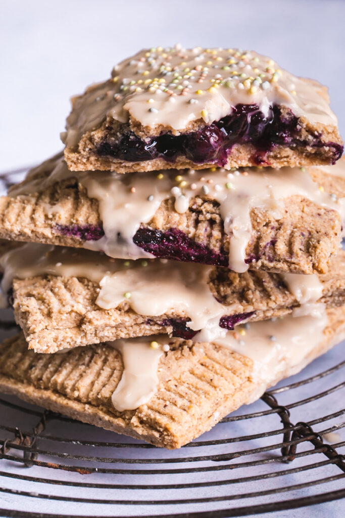 a close up of blueberry lemon pop tarts stacked on top of one another