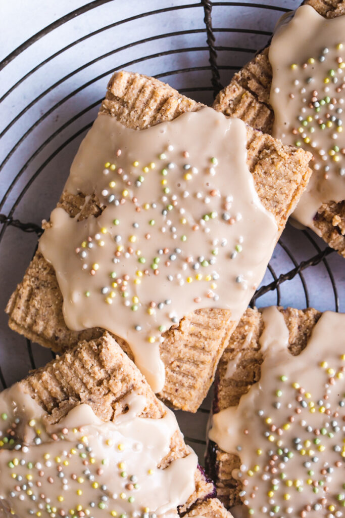a flatlay close up shot of frosted pop tarts with colored sprinkles