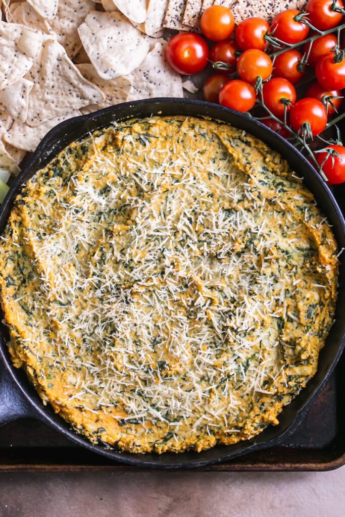 close up of the castiron skillet of spinach artichoke dip