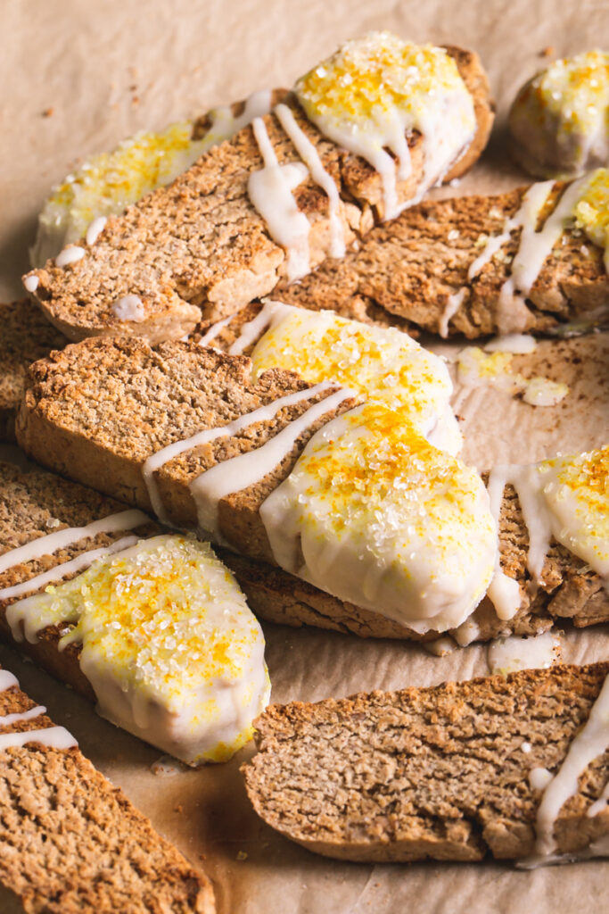 3/4 close up view of lemon vanilla biscotti stacked on top of one another