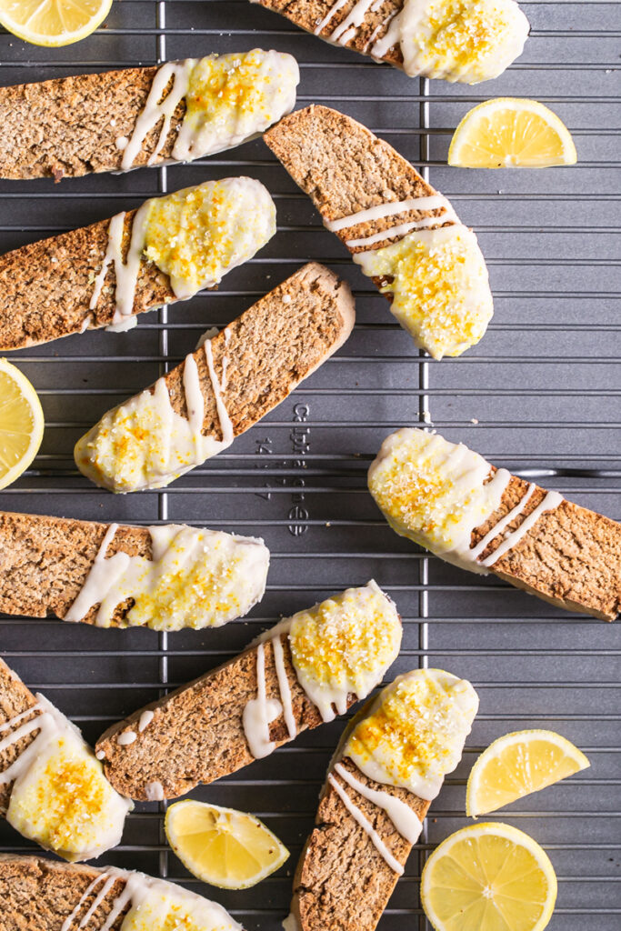 lemon vanilla biscotti on a Calphalon cooking rack on top of a Calphalon cookie sheet