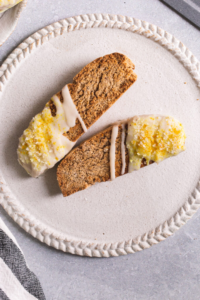 two lemon vanilla biscotti on a white plate
