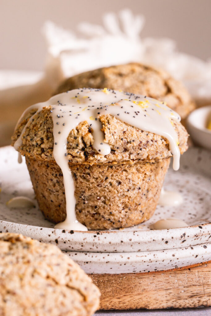 a close up image of a lemon poppy seed muffin drizzled with icing