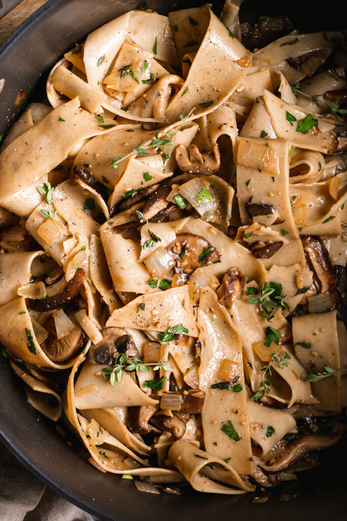 close up of gluten-free pappardelle with wild mushroom Ragù
