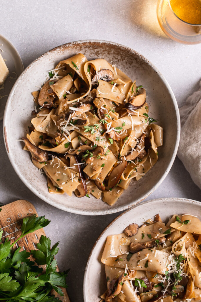 two bowls of gluten-free pappardelle with wild mushroom Ragù