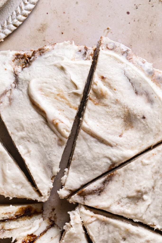 close up of the sliced cinnamon roll dessert pizza
