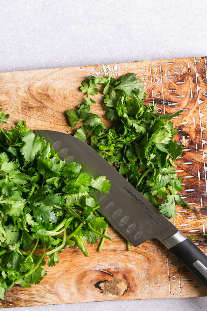 action shot of hands chopping cilantro