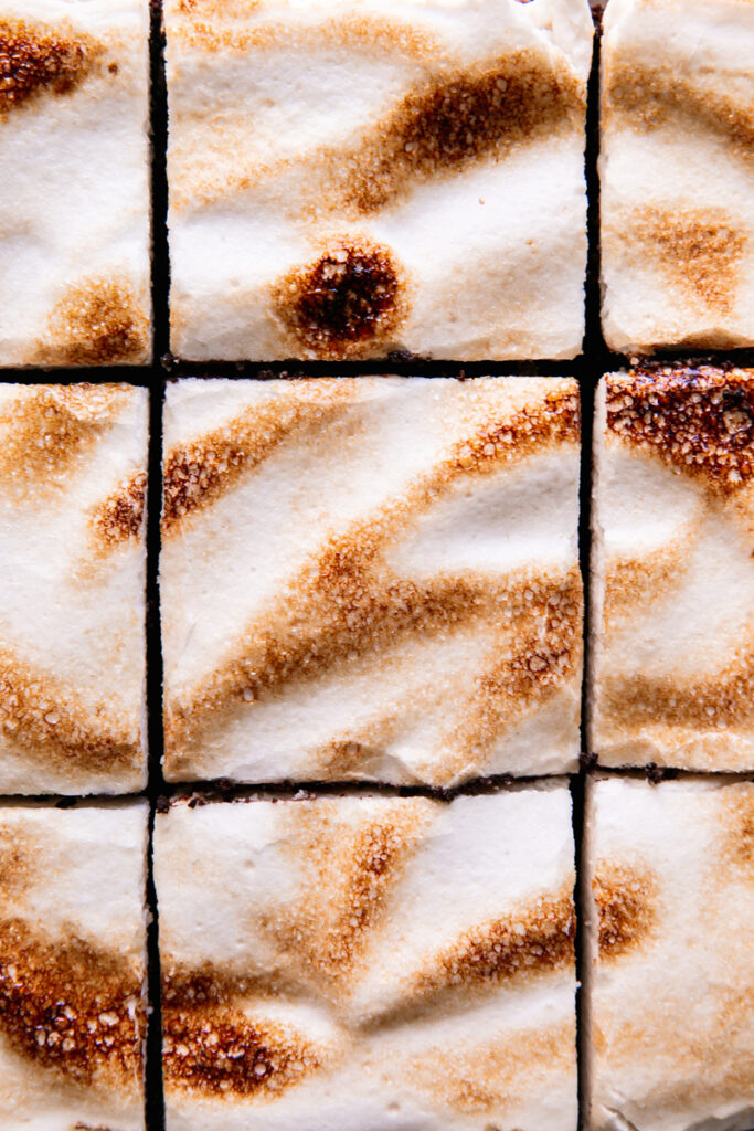 full image of the toasted marshmallow fluff layer on top sliced into squares