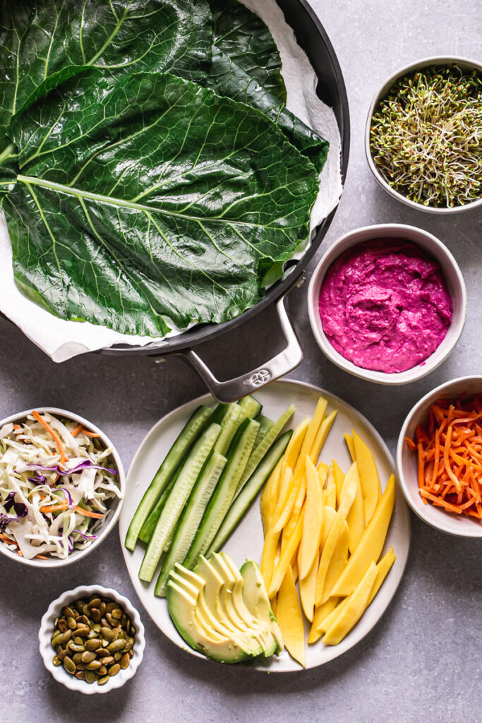 all of the ingredients to make these beet hummus veggie collard wraps laid out together