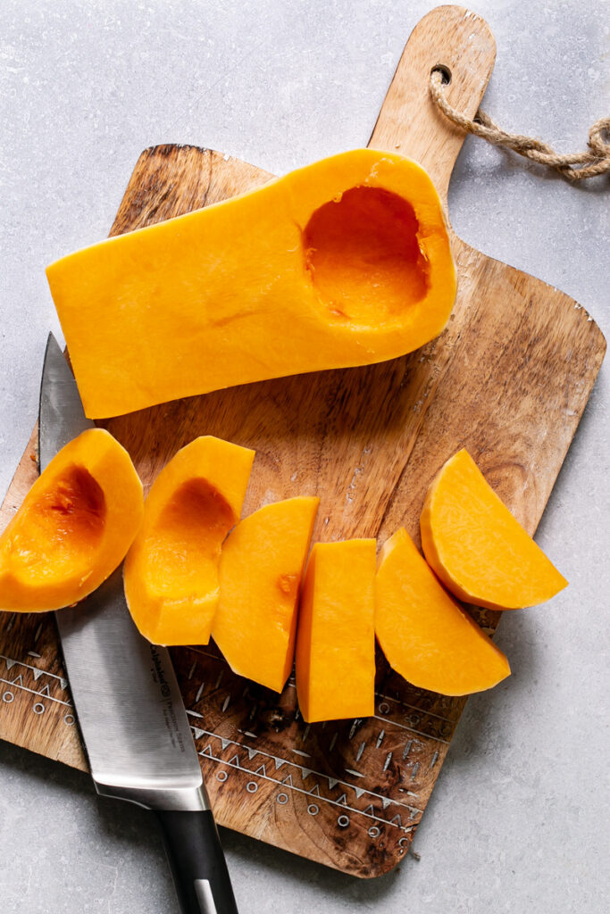 half of the butternut squash cut in slices